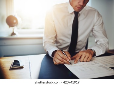 Business man or accountant lawyer working on documents, close up business concept