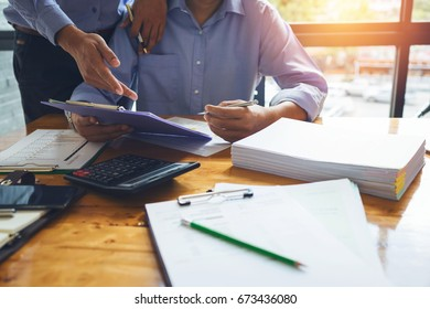 Business man accountant working hard of accounting financial report of annual 2017 with tax paperwork or job order product.