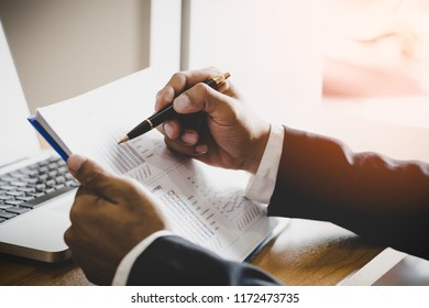 business man accountant working on documents looking concentrated on the table