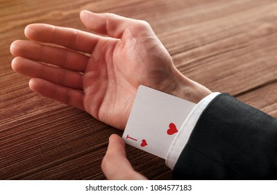 Business man with ace in his sleeve.