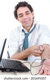 business man addicted to internet put USB cable from laptop into his vein. Internet addiction concept