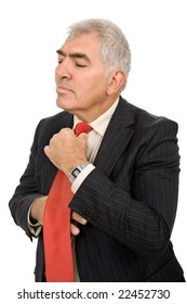 business man adjusting his tie isolated on white