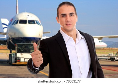 Business man at the airport thumb up