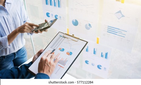 Business man analysis data document with blurred accountant calculating