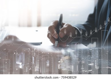 Business man analysis on digital stock market financial background. Stock market financial analysis on virtual screen led with cityscape double exposure, stock market financial concept
