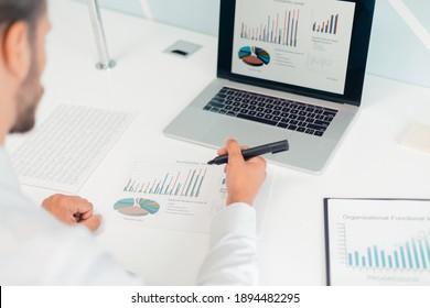 business man analyzing financial data . rear view.