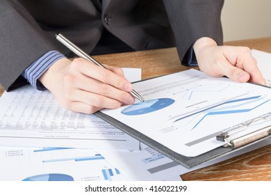 business man analyzing graph and chart document report, business performance concept