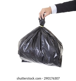 A business man arm holding a black bag of trash concept bad debt theme, bad investments, bad business