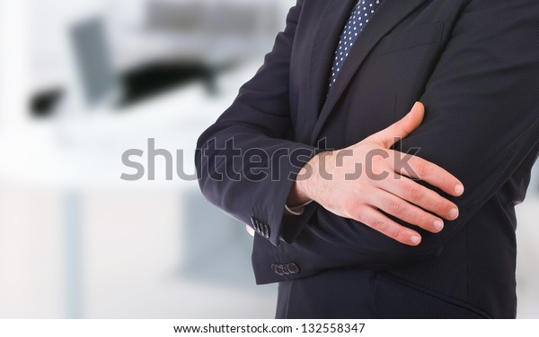 business-man-arms-crossed-600w-132558347