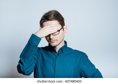 Business man is ashamed, isolated on a gray background