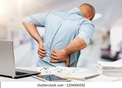 Business man with back pain sin an
