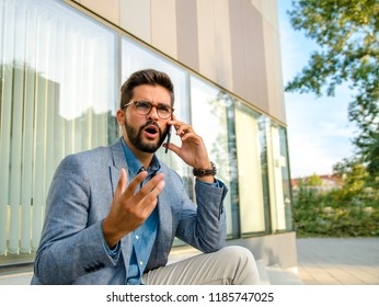 Business man in bad conversation on smartphone
