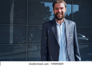 business man with a beard smiling