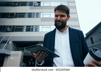 Business man with a beard with a tablet