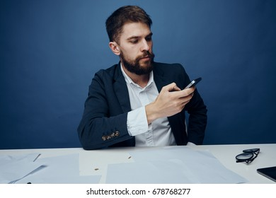 Business man with a beard working at his desk in the office.