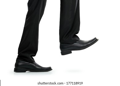 Business man in black shoes walking or stepping.
