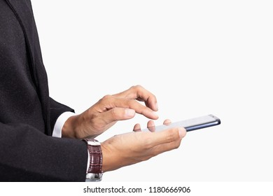 Business man in black suit using and touch screen display on technology smartphone isolated white background