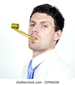 Business man blows party blower while wearing whit shirt.