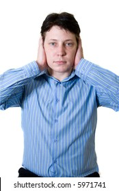 Business man with blue shirt holding both hands on his ears to prevent him from hearing