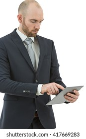 Business man browsing on tablet computer