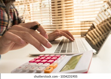 Business man calculate about cost and doing finance at office, Finance managers task, Concept business and financial investment