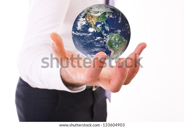 business-man-carrying-earth-elements-600