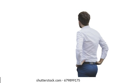 Business man or casual dressed man looking at a empty white wall. Copy space