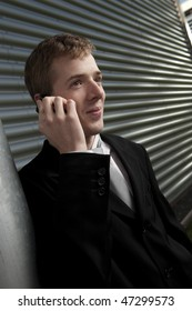 Business man chatting happily on his cellphone.
