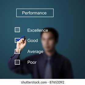 business man checking  good on performance evaluation form