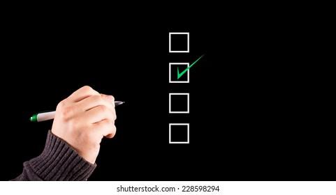 business man checking on a checklist box