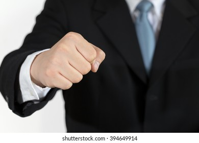 Business man with clenched fist on white background