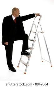 Business man climbing up the success ledder