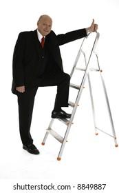 Business man climbing up the success ledder shwoing thumbs up