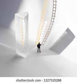 Business man contemplating a ladder he needs to climb. Promotion, goal, achievement and leadership concept. The start of a business venture or new skill. A dreamscape of rising up the corporate ladder