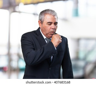 business man coughing