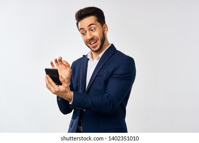 business man counts on a calculator on a light background