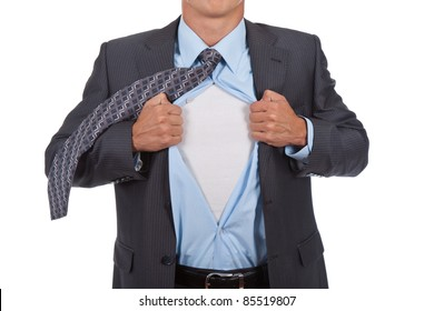 business man with courage and superman concept tearing off his shirt isolated over white background