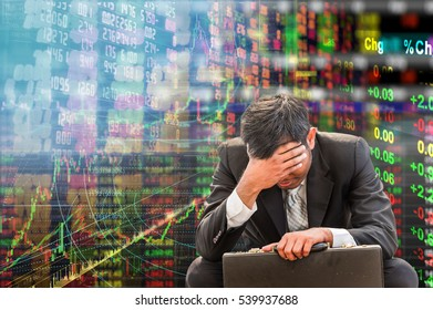 Business man crying after he paid all money buy many stock between bull market and never sell.Now the price is falling for a month. Oil market is lower price. Only gold market is going up.He is broke.