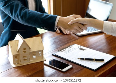 business man and customer handshake for their agreement to sign for contract for new home buy or rent
