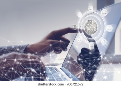 Business man or customer makes an online shopping via laptop computer and web icons flow on virtual screen, omnichannel or multichannel marketing, internet of things IoT concept