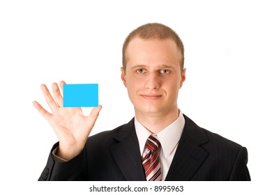Business man in dark suit holding blank card