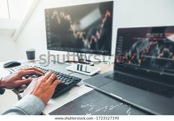 Business man deal Investment stock market discussing graph stock market trading Stock traders concept.