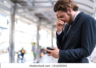 Business man disappoint in the communication with smartphone.