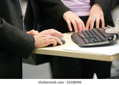 business man displaying something on the computer
