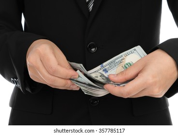 Business man Displaying a Spread of Dollar