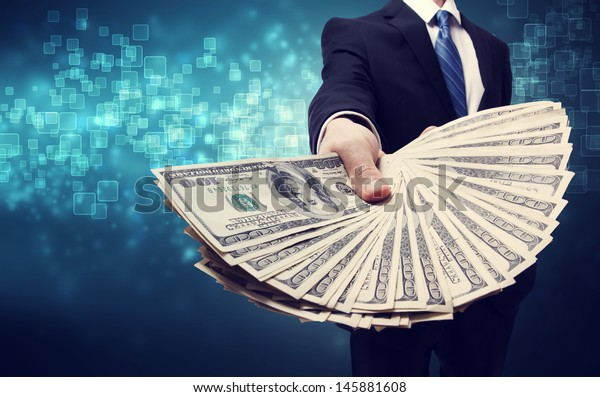 Business Man Displaying Spread of one hundred dollar bills