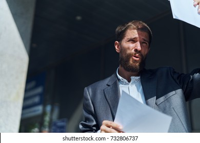 business man with documents on building background
