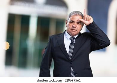 business man doing a looser gesture