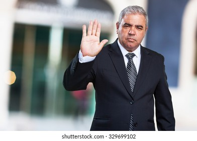 business man doing a stop gesture