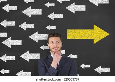 Business Man Drawing Change Concepts on Blackboard